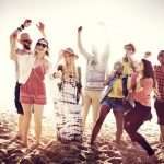 Music lovers dancing on the beach, GoRoamin travel gifts blog