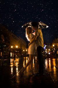 Couple under umbrella in the rain, GoRoamin travel gifts blog