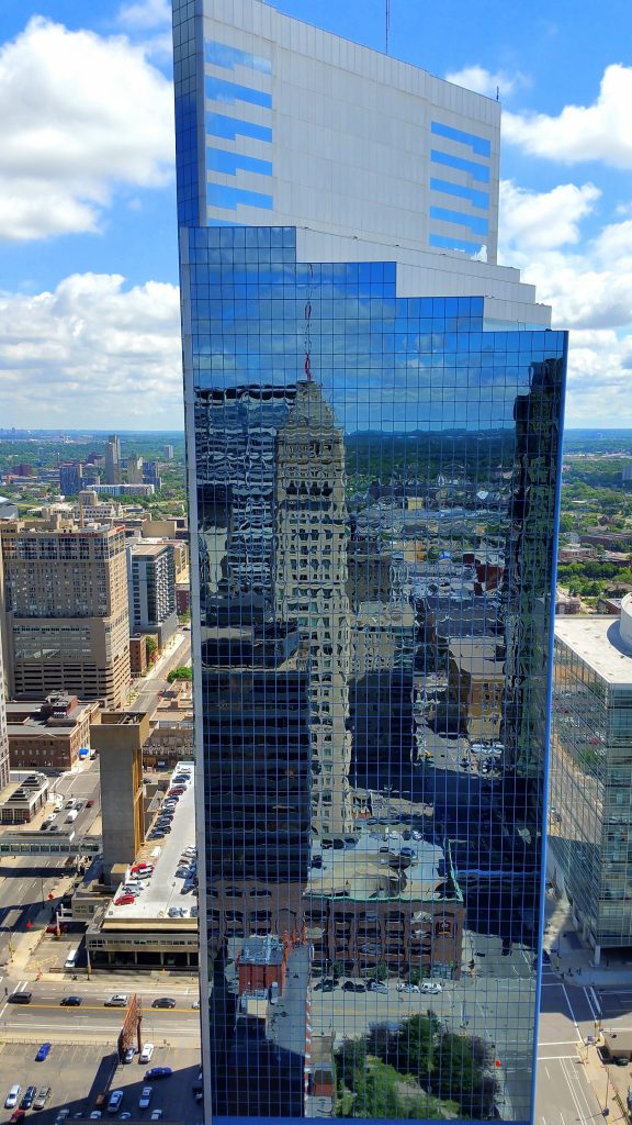 Minneapolis skyscraper with reflection of Foshay Tower. GoRoamin Travel Blog