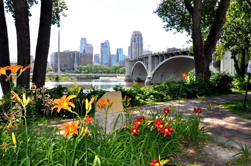 Stone Arch Bridge, Minneapolis skyline. GoRoamin Travel Blog